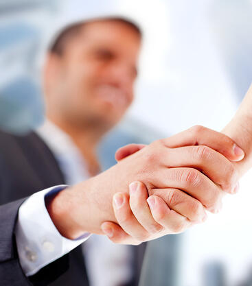 Business man closing a deal with a handshake