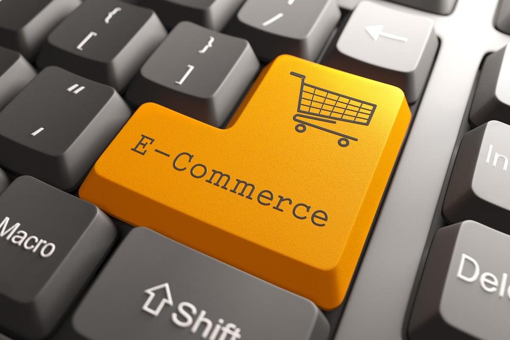 Orange E-Commerce Button on Computer Keyboard. Internet Concept.