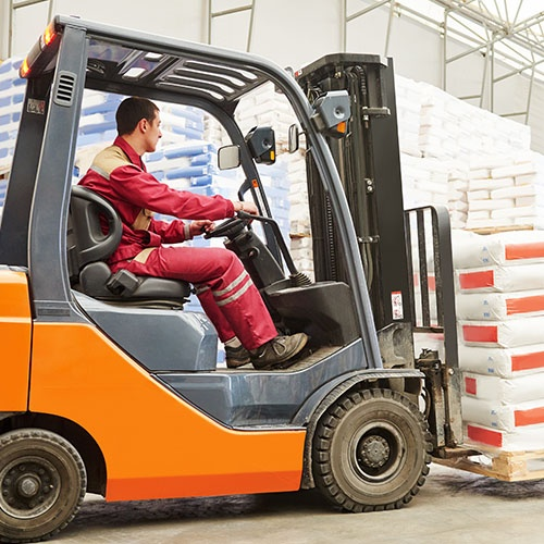 An image of a forklift carrying a pallet of goods