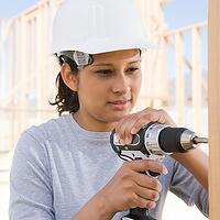 An image of a woman constructing a house