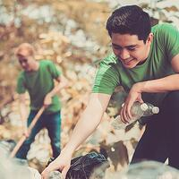 An image of volunteers cleaning up a park